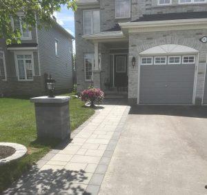 driveway widening grey stones grey house